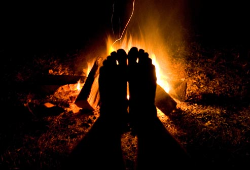 getty_rf_photo_of_feet_in_front_of_campfire